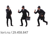Купить «Man spy with handgun isolated on white background», фото № 29458847, снято 6 ноября 2017 г. (c) Elnur / Фотобанк Лори