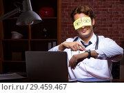 Купить «Young handsome doctor working night time at the hospital», фото № 29459467, снято 28 августа 2018 г. (c) Elnur / Фотобанк Лори