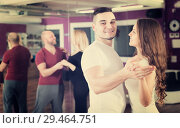 Купить «Couples enjoying of partner dance», фото № 29464751, снято 29 марта 2020 г. (c) Яков Филимонов / Фотобанк Лори
