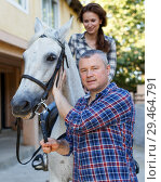Купить «Man trainer teach to female while riding horse at ranch», фото № 29464791, снято 4 июля 2018 г. (c) Яков Филимонов / Фотобанк Лори