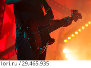 Купить «Electric bass guitar player in bright stage lights», фото № 29465935, снято 11 декабря 2016 г. (c) EugeneSergeev / Фотобанк Лори