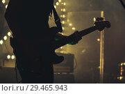 Купить «Electric bass guitar player on the stage», фото № 29465943, снято 11 декабря 2016 г. (c) EugeneSergeev / Фотобанк Лори