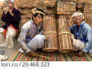Купить «Cham playing traditional music at the Po Nagar Cham Towers in Nha Trang, Vietnam.», фото № 29468323, снято 23 сентября 2018 г. (c) age Fotostock / Фотобанк Лори