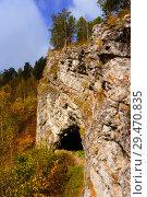 Купить «Cave entrance under rocky outcrop in autumn mountain landscape», фото № 29470835, снято 23 сентября 2018 г. (c) Евгений Харитонов / Фотобанк Лори