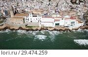 Купить «Aerial view of Sitges small town with church on Mediterranean coastline, Spain», видеоролик № 29474259, снято 27 апреля 2018 г. (c) Яков Филимонов / Фотобанк Лори