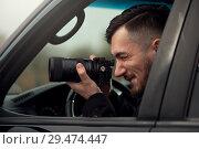 Купить «Close-up - Young Man Photorapher Sitting In The Car», фото № 29474447, снято 8 ноября 2018 г. (c) Pavel Biryukov / Фотобанк Лори