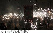 Купить «Cheerful people dressed as devils with fireworks during Correfoc on traditional Catalan La Merce festival», видеоролик № 29474467, снято 22 сентября 2018 г. (c) Яков Филимонов / Фотобанк Лори