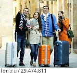 Купить «Portrait of tourists with map», фото № 29474811, снято 27 февраля 2020 г. (c) Яков Филимонов / Фотобанк Лори