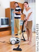 Купить «Couple cleaning flat together», фото № 29474819, снято 19 января 2019 г. (c) Яков Филимонов / Фотобанк Лори