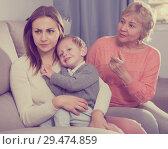 Купить «Two women are quarreling for upbringing toddler», фото № 29474859, снято 15 февраля 2018 г. (c) Яков Филимонов / Фотобанк Лори
