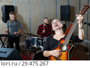 Купить «excited girl rock singer with guitar during rehearsal», фото № 29475267, снято 26 октября 2018 г. (c) Яков Филимонов / Фотобанк Лори