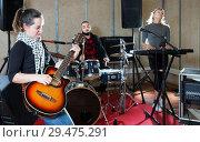 Купить «excited girl rock singer with guitar during rehearsal», фото № 29475291, снято 26 октября 2018 г. (c) Яков Филимонов / Фотобанк Лори