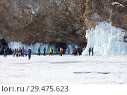 Купить «Baikal Lake. A group of tourists travels around Olkhon Island and take pictures of beautiful icicles on icy coastal cliffs», фото № 29475623, снято 8 марта 2015 г. (c) Виктория Катьянова / Фотобанк Лори
