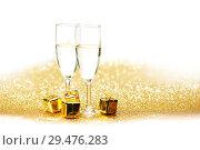 Купить «Champagne and gift», фото № 29476283, снято 25 сентября 2013 г. (c) Иван Михайлов / Фотобанк Лори