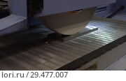 Купить «Work of an industrial surface grinding machine. Grinding of a flat metal part.», видеоролик № 29477007, снято 26 октября 2018 г. (c) Андрей Радченко / Фотобанк Лори