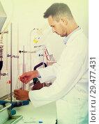 Купить «attentive man making tests in wine manufactory laboratory», фото № 29477431, снято 19 января 2019 г. (c) Яков Филимонов / Фотобанк Лори