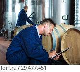 Купить «young man expert in winery», фото № 29477451, снято 19 января 2019 г. (c) Яков Филимонов / Фотобанк Лори