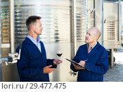 Купить «Workers taking notes wine sample», фото № 29477475, снято 19 января 2019 г. (c) Яков Филимонов / Фотобанк Лори