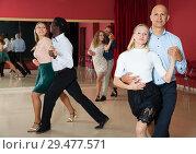 Купить «Adult pairs practicing salsa movements in modern dance studio», фото № 29477571, снято 4 октября 2018 г. (c) Яков Филимонов / Фотобанк Лори