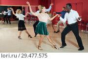 Купить «Young people dancing lindy hop in pairs in modern dance hall», фото № 29477575, снято 4 октября 2018 г. (c) Яков Филимонов / Фотобанк Лори
