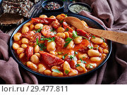Купить «beans stew with sausages in a bowl», фото № 29477811, снято 20 ноября 2018 г. (c) Oksana Zh / Фотобанк Лори