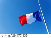 Купить «Lowered to half-staff flag of France over blue sky», фото № 29477835, снято 25 мая 2017 г. (c) Сергей Новиков / Фотобанк Лори