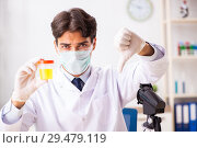 Young handsome chemist working in the lab. Стоковое фото, фотограф Elnur / Фотобанк Лори