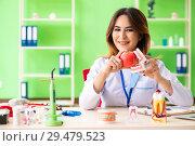 Купить «Woman dentist working on teeth implant», фото № 29479523, снято 11 июня 2018 г. (c) Elnur / Фотобанк Лори