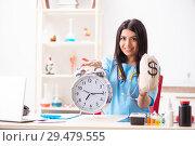 Купить «Young beautiful female doctor working in the clinic», фото № 29479555, снято 12 июля 2018 г. (c) Elnur / Фотобанк Лори