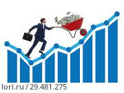 Купить «Businessman pushing wheelbarrow full of dollar money», фото № 29481275, снято 23 апреля 2019 г. (c) Elnur / Фотобанк Лори