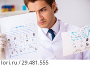 Купить «Forensic expert studying fingerprints in the lab», фото № 29481555, снято 31 августа 2018 г. (c) Elnur / Фотобанк Лори