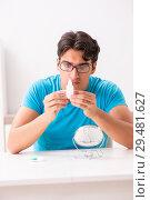 Купить «Man trying contact lenses at home», фото № 29481627, снято 6 августа 2018 г. (c) Elnur / Фотобанк Лори