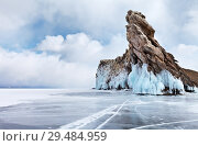 Купить «Baikal Lake in winter day. Beautiful unusual Ogoy Island with  ice crust and icicles on coastal rocks on background of cumulus clouds. Cape Dragon - a natural landmark and a favorite place for tourists», фото № 29484959, снято 1 марта 2015 г. (c) Виктория Катьянова / Фотобанк Лори