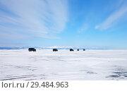 Купить «A group of tourists on off-road cars travels on the ice of frozen Lake Baikal. Winter extreme auto tours», фото № 29484963, снято 8 марта 2015 г. (c) Виктория Катьянова / Фотобанк Лори