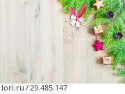 Купить «New Year and Christmas background.Christmas toys, green fir tree branches on the wooden background», фото № 29485147, снято 8 мая 2017 г. (c) Зезелина Марина / Фотобанк Лори