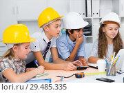 Купить «Teens engineers discussing draft at the table», фото № 29485335, снято 12 октября 2017 г. (c) Яков Филимонов / Фотобанк Лори