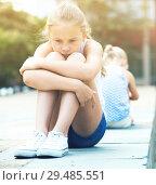 Купить «Two offended girls after quarrel outdoors», фото № 29485551, снято 20 июля 2017 г. (c) Яков Филимонов / Фотобанк Лори