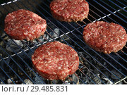 Raw beef burger for hamburger on barbecue grill. Стоковое фото, фотограф Anton Eine / Фотобанк Лори