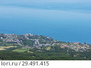 Resort town on the seashore. Russia, the Republic of Crimea. 13.06.2018. Town of Gaspra. View from Mount Ai-Petri. Стоковое фото, фотограф Вадим Орлов / Фотобанк Лори