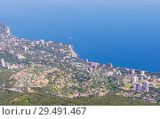 View from the top of the mountain to the seaside town. Russia, Republic of Crimea. 06.13.2018. Koreiz is an urban-type settlement on the southern coast of Crimea, located on the southern slope of the Crimean Mountains, near the foot of Ai-Petri Mountain. Стоковое фото, фотограф Вадим Орлов / Фотобанк Лори