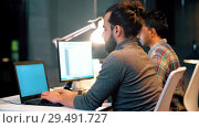 Купить «programmer with computers working at night office», видеоролик № 29491727, снято 23 мая 2019 г. (c) Syda Productions / Фотобанк Лори