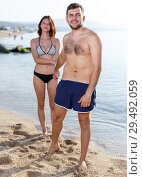 Купить «Young couple dressed in beachwear», фото № 29492059, снято 27 июня 2018 г. (c) Яков Филимонов / Фотобанк Лори