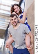 Купить «Young loving couple have a good time», фото № 29492071, снято 27 июня 2018 г. (c) Яков Филимонов / Фотобанк Лори