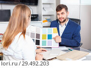 Купить «Competent seller in showroom helping young female client to choose furniture materials for her apartment», фото № 29492203, снято 9 апреля 2018 г. (c) Яков Филимонов / Фотобанк Лори