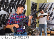 Купить «Men choosing air weapon», фото № 29492279, снято 4 июля 2017 г. (c) Яков Филимонов / Фотобанк Лори