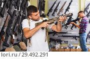 Купить «Men choosing air weapon», фото № 29492291, снято 4 июля 2017 г. (c) Яков Филимонов / Фотобанк Лори