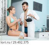 Купить «couple relaxing and drinking tea after spa treatments», фото № 29492375, снято 24 апреля 2018 г. (c) Яков Филимонов / Фотобанк Лори