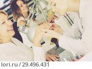 Купить «Woman doing manicure», фото № 29496431, снято 2 ноября 2016 г. (c) Яков Филимонов / Фотобанк Лори