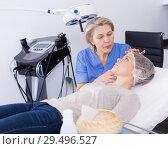 Купить «Cosmetologist consulting young woman», фото № 29496527, снято 16 марта 2018 г. (c) Яков Филимонов / Фотобанк Лори
