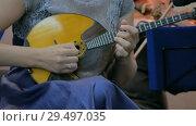 Woman playing mandolin. Стоковое видео, видеограф Aleksey Popov / Фотобанк Лори